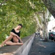 Young beautiful ballerina dancing in Tevere riverside in Rome — Stockfoto