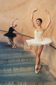 Young beautiful ballerinas dancing on the stairs. Ballerinas — Stock Photo