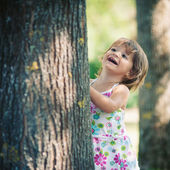 One year little girl playing in the park portrait. — Stok fotoğraf
