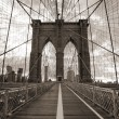 Brooklyn Bridge in New York City. Sepia tone. - Stock Photo