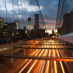 Manhattan skyline from the Brooklyn bridge at dusk — Stock Photo