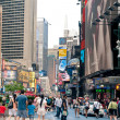 NEW YORK CITY - JUNE 28: walking in Times Square, a busy tourist intersection of commerce Advertisements and a famous street of New York City and US, seen on June 28, 2012 in New York, NY. — Stock Photo
