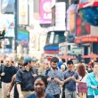 NEW YORK CITY - JUNE 28: crossing the street in Times Square, a busy tourist intersection of commerce ADV and a famous street of New York City and US, seen on June 28, 2012 in New York, NY. — Stockfoto