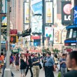 Stock Photo: NEW YORK CITY - JUNE 28: walking in Times Square, busy tourist intersection of commerce Advertisements and famous street of New York City and US, seen on June 28, 2012 in New York, NY.