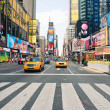 NEW YORK CITY - JUNE 28: walking in Times Square, a busy tourist intersection of commerce Advertisements and a famous street of New York City and US, seen on June 28, 2012 in New York, NY. — Foto Stock