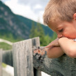 Stock Photo: Portrait of four year old boy outdoors in the mountains. Dolomit