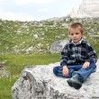 Royalty-Free Stock Photo: Portrait of 4 years kid outdoors in the mountains. Dolomites, It