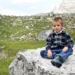 Portrait of 4 years kid outdoors in the mountains. Dolomites, It - Stock Photo