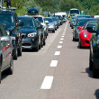 BOZEN, ITALY - JULY 31: Traffic jam driving back to the south on July 31, 2012 in Bozen, Italy. The A22 freeway in summertime from north to south register more than 200,000 vehicles a day. - Stock Photo