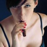Woman smoking cigar. Studio fashion photo. — Stock Photo #14440963