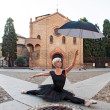 Young beautiful ballerina posing in front of St. Stephen church — Stock Photo