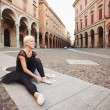 Young beautiful ballerina relaxing out in the street in St. Stephen church — Stock Photo