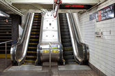 Interior view with escalators of subway station in NYC. — Stock Photo