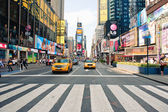 NEW YORK CITY - JUNE 28: walking in Times Square, a busy tourist intersection of commerce Advertisements and a famous street of New York City and US, seen on June 28, 2012 in New York, NY. — Foto de Stock