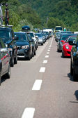 BOZEN, ITALY - JULY 31: Traffic jam driving back to the south on July 31, 2012 in Bozen, Italy. The A22 freeway in summertime from north to south register more than 200,000 vehicles a day. — Stock Photo