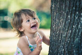 One year little girl playing in the park portrait. — Stock Photo