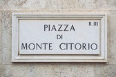 Street plate of famous Piazza di Monte Citorio. Rome. Italy. — Stock Photo