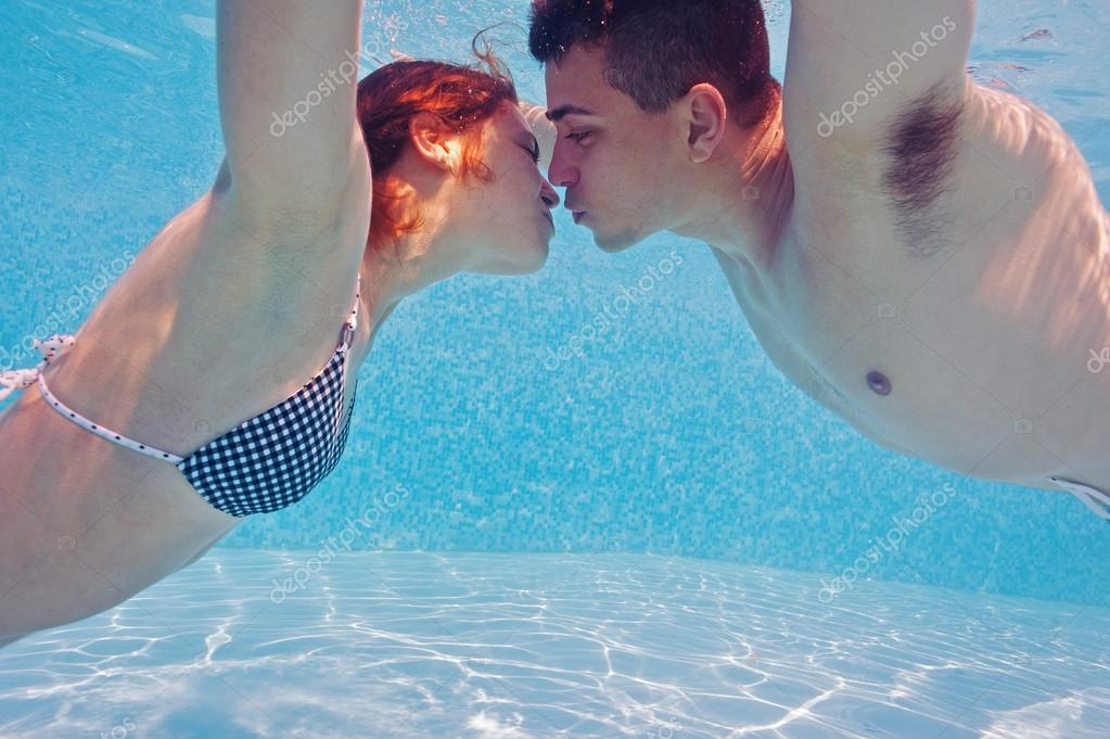 underwater couple kissing in swimming pool stock photo pio3 14440761
