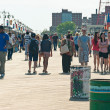 Stock Photo: NEW YORK - JUNE 27: walking long Riegelmann Boardwalk on