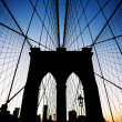 Brooklyn Bridge in New York at dusk. - Stock Photo