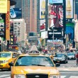 Times Square is a busy tourist intersection of commerce Advertisements and a famous street of New York City and US — Stock Photo