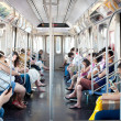 Постер, плакат: Commuters in subway wagon on June 29 2012 in NYC