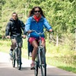Stock Photo: :Couple outdoors on bike. Bicycle path from St. Candid in italy