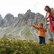 Mother and son walking in Dolomites, Italy. - Stock Photo