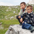 Royalty-Free Stock Photo: Portrait of two brothers outdoors in the mountains. Dolomites, Italy