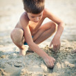 Kid playing on the beach in a sunny day. — Stock Photo #14581351