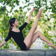 Young beautiful ballerina dancing in Tevere riverside in Rome, Italy - Stock Photo