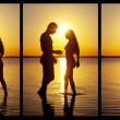 Stock Photo: Couple silhouette at the beach kissing each others.