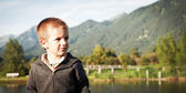 Portrait of four year old boy outdoors in the mountains — Stok fotoğraf