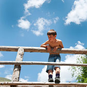 Portrait of six year old boy outdoors in the mountains. — Stock Photo