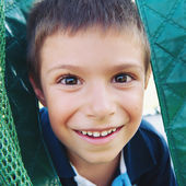 Close up portrait of smiling six year old boy. — Stock Photo