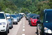 Traffic jam driving back to the south on July 31, 2012 in Bozen, Italy. — Stock Photo