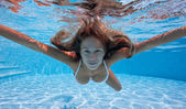 Underwater woman portrait with white bikini in swimming pool. — Stock Photo
