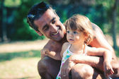 Portrait of father and young daughter In a park. — Foto de Stock