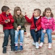 Kids playing against a wall — Stock Photo #14633225
