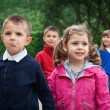 Kids walking outdoors in a park — Stock Photo