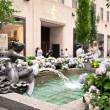 NEW YORK - JUNE 22: Rockefeller Center fountain on Fifth Avenue - Stock Photo