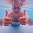 Underwater portrait of happy man in a swimming pool. Shallow DOF — Stock Photo