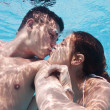 Stock Photo: Underwater couple kissing in swimming pool