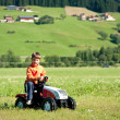 Kid playing with tractor toy outdoors — Stock Photo