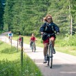 Stock Photo: Family outdoors on byke. Bicycle path from St. Candid in Italy