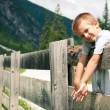 Portrait of four year old boy outdoors in the mountains. Dolomit — Foto Stock