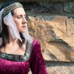Beautiful girl wearing a burgundy medieval dress — Stock Photo