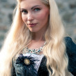 Beautiful girl wearing a medieval dress — Stock Photo #14634093