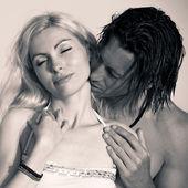 Romantic couple at the beach. Sepia tone — Stock Photo