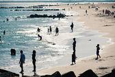 Enjoying Coney Island sandy beach, New York City — Stock Photo